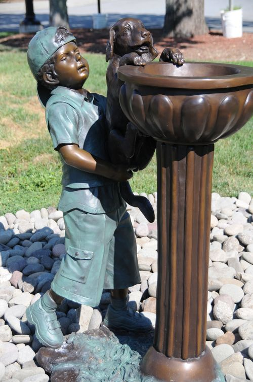 Boy and dog statue