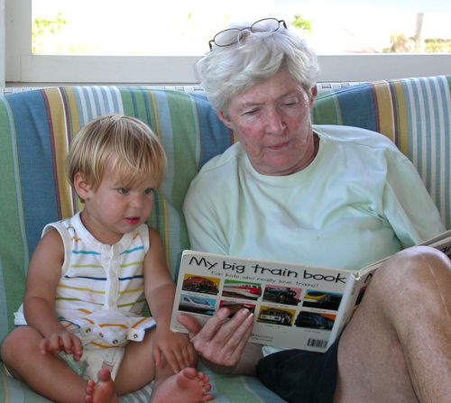 Baby and grandmother reading